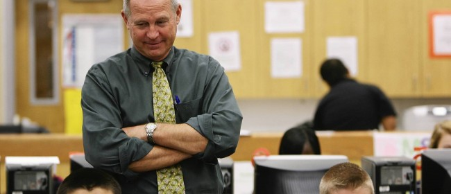 Leesburg High School principal Bill Miller visits a class room on Friday, April 20, 2012. Leesburg High School school is a recipient of a federal grant to help turn around its grades. (Tom Benitez/Orlando Sentinel)